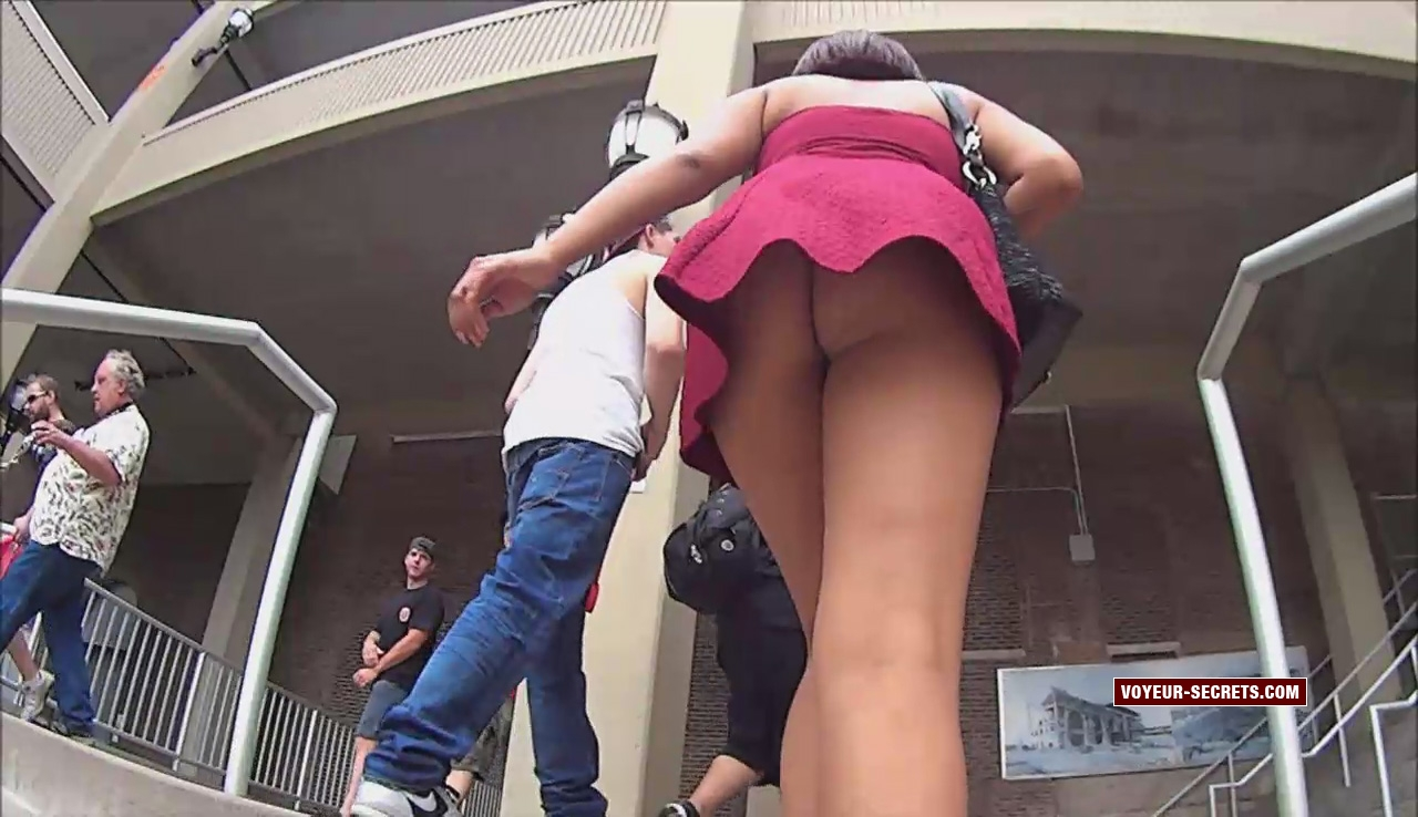 Black girl's upskirt reveals her big ass and thin thong