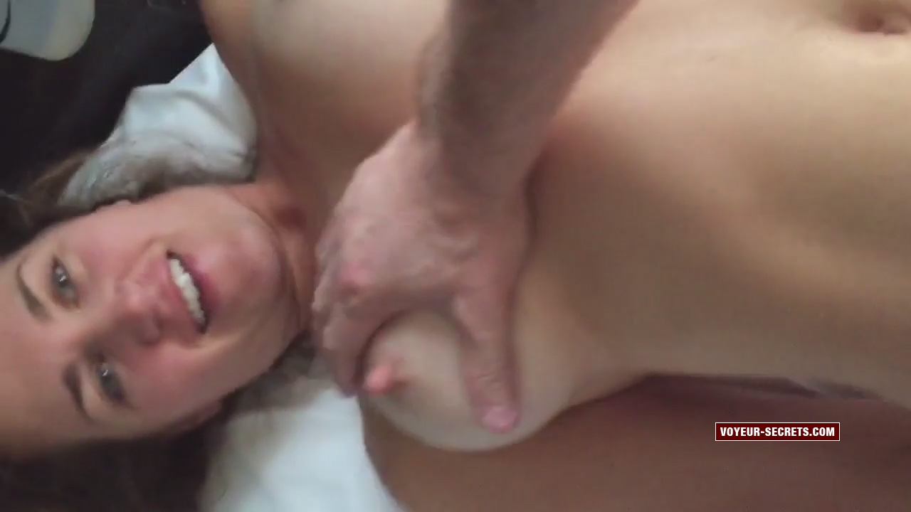 Hard nipples and smile of horny girl while she is having sex