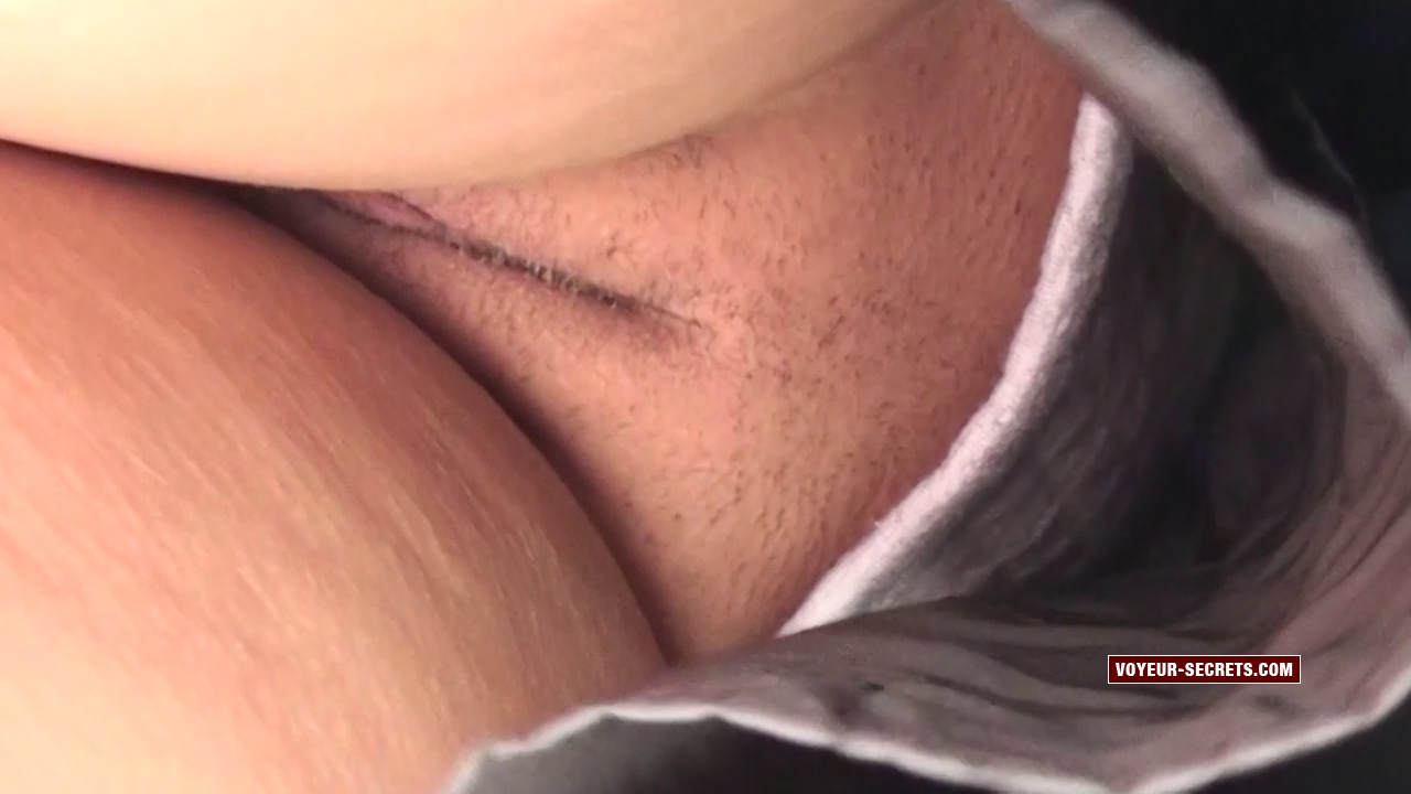 Slightly hairy pussy in upskirt of hot business woman