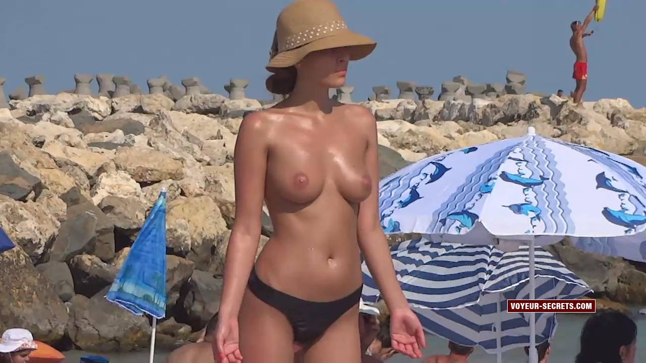 Hot natural breasts of gorgeous woman on beach