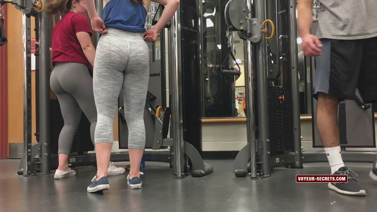 Silly twin sisters clumsily exercise in gym while voyeur photographs their big butts
