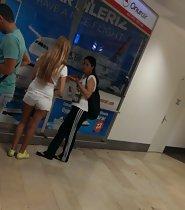 Gorgeous teen girl in white shorts