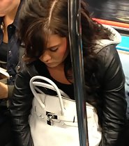 Curly beauty in a subway train