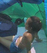 Peeping a cute girl in the beach tent