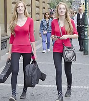 Skinny twin sisters in matching outfits