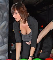 Bowling girl's big boobs slipping out