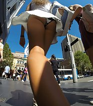 Hot tanned ass and panties in upskirt