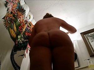 Hidden camera on big butt in bathroom