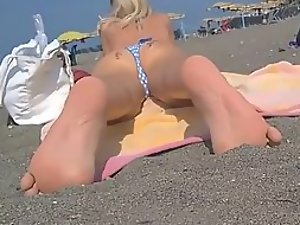 Teen girl plays with her sweet little toes