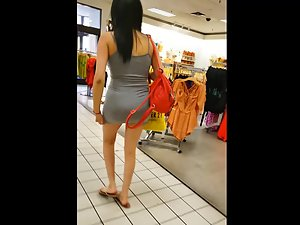 Unreal ass is barely covered by short dress