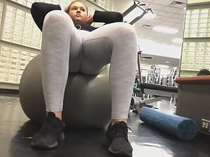 Teen girl exercises on pilates ball
