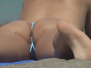 Pussy lips and asshole slip from bikini Picture 3