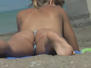 Pussy lips and asshole slip from bikini Picture 6