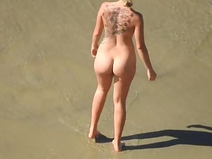 Tattooed nudist woman got pear body shape