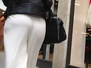 Huge butt in loose white pants