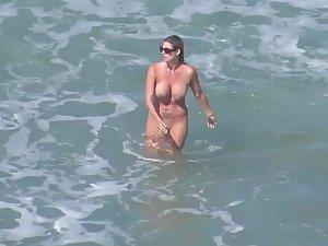 Sexy mermaid with big fake boobs