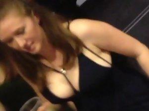 Little black dress reveals her big boobs