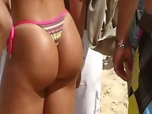 Admiration of a hot ass on a beach party