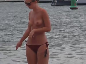 Topless girl with small tits and pear body shape