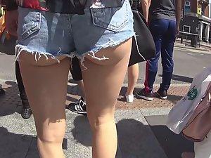 Ass cheeks halfway out of cutoff shorts