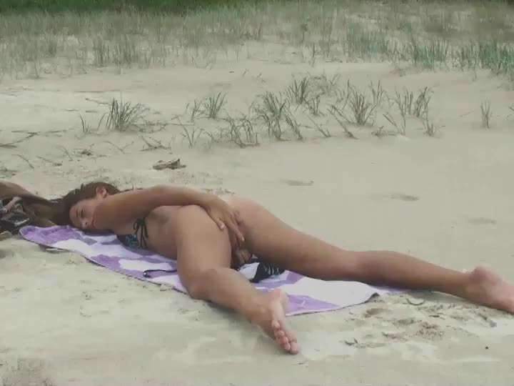 fingering herself on the beach