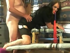 Gagged milf fucked hard from behind