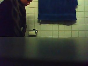 Hot girl pissing in a public toilet Picture 3