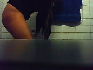Hot girl pissing in a public toilet