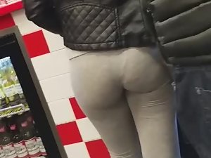 Waiting in line behind a thick round ass