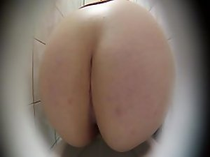 Firm big ass of a pissing girl gets spied