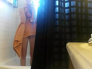 Petite sister pissing and showering Picture 7