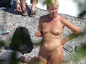 Spying on nudist milfs from the bushes