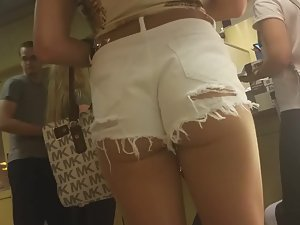 Incredible ass in torn white shorts