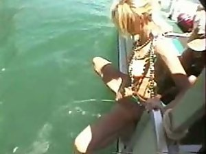 Fun loving girl pissing from a boat