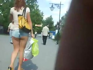 Creeping a girl with tucked in hot pants Picture 2
