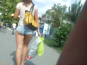 Creeping a girl with tucked in hot pants Picture 5