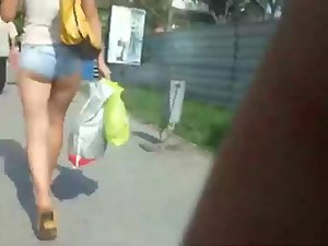 Creeping a girl with tucked in hot pants Picture 6