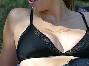 Shameless sunbathing in her black bra
