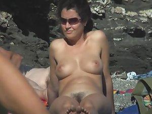 Lovely hairy pussy on nudist beach