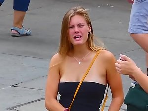 Fantastic big boobs almost slipping out of top