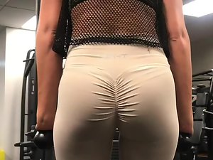 Fit ass in wrinkled tights at the gym