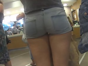 Teen in shorts at fast food line