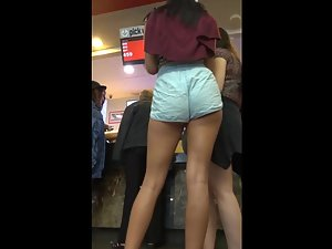 Leggy girl's hot ass falls out of loose shorts