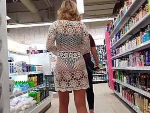 Bubble butt seen through white beach dress