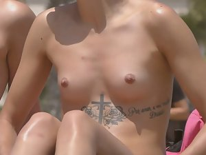 Sexy tattoo on tiny topless babe