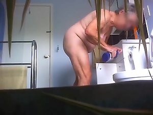 Spying my mum home alone totally naked in the kitchen