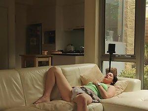 Bored babbysitter masturbates on sofa Picture 1