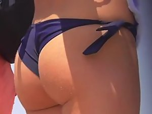 Tight bubbly ass in a small bikini
