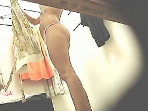 Hot lady putting a long dress on