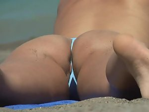 Pussy slip out of a tiny bikini Picture 5
